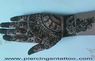 Henna tattoo by disha singh.